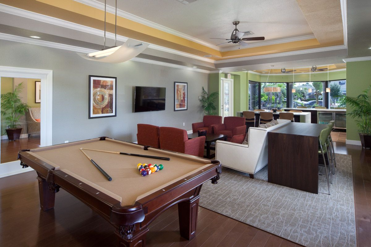 Entertainment room in clubhouse with pool table and TV