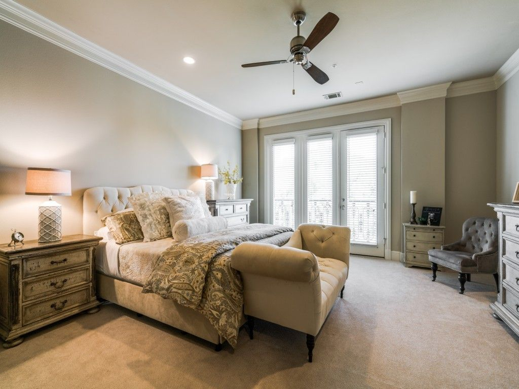 Spacious master bedroom with french doors