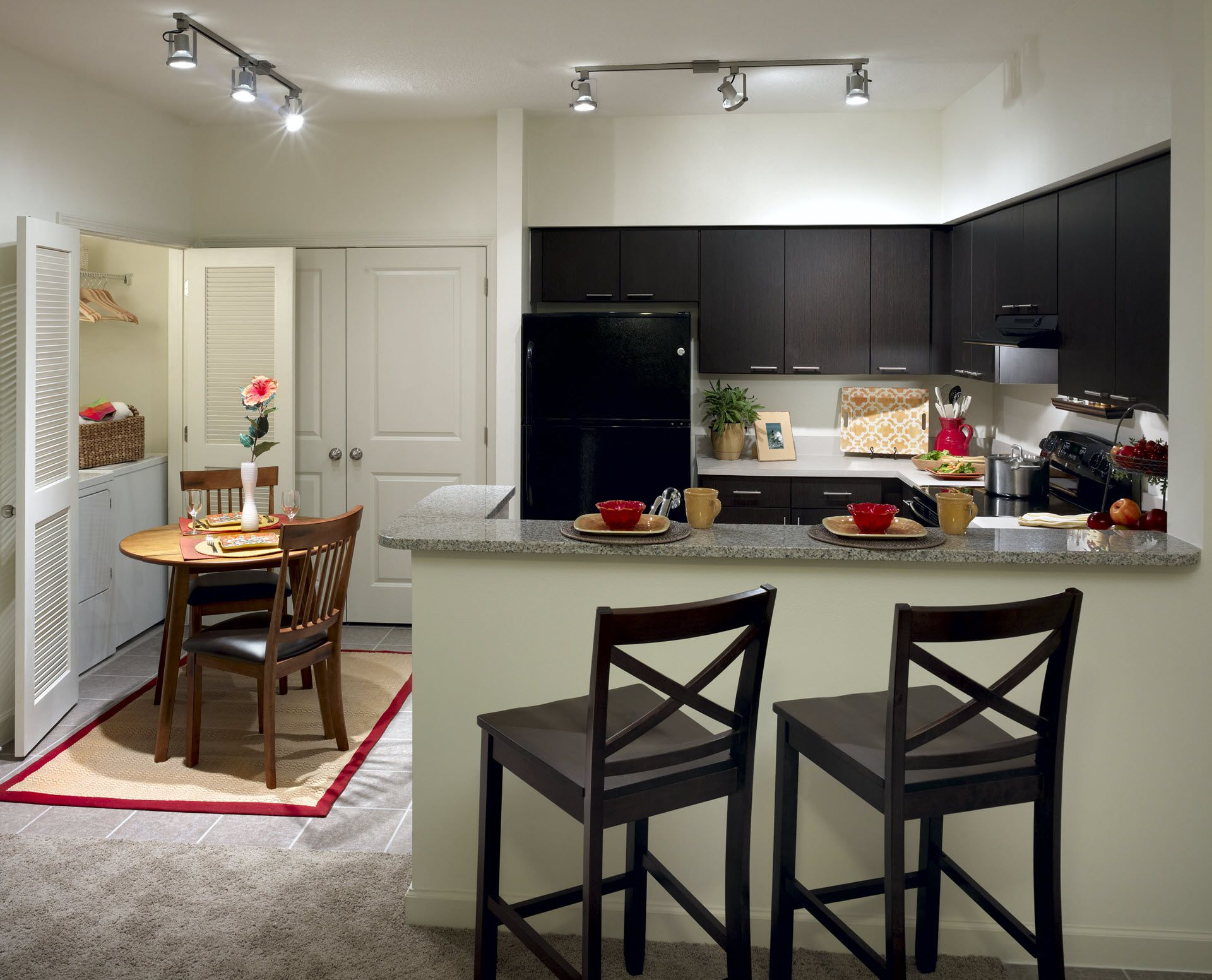 Apartment kitchen with black appliances and bar seating