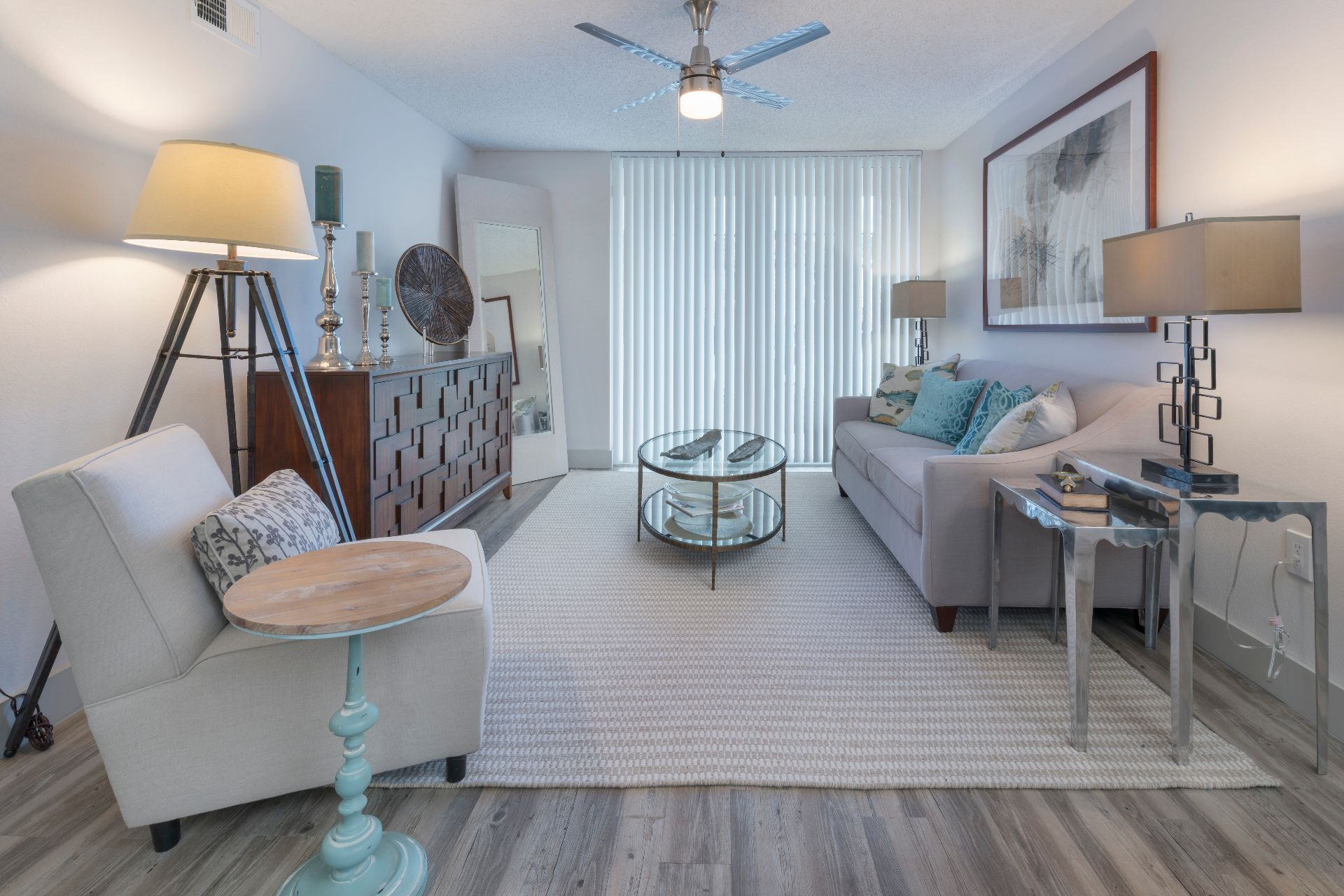 Living room with rug and ceiling fan