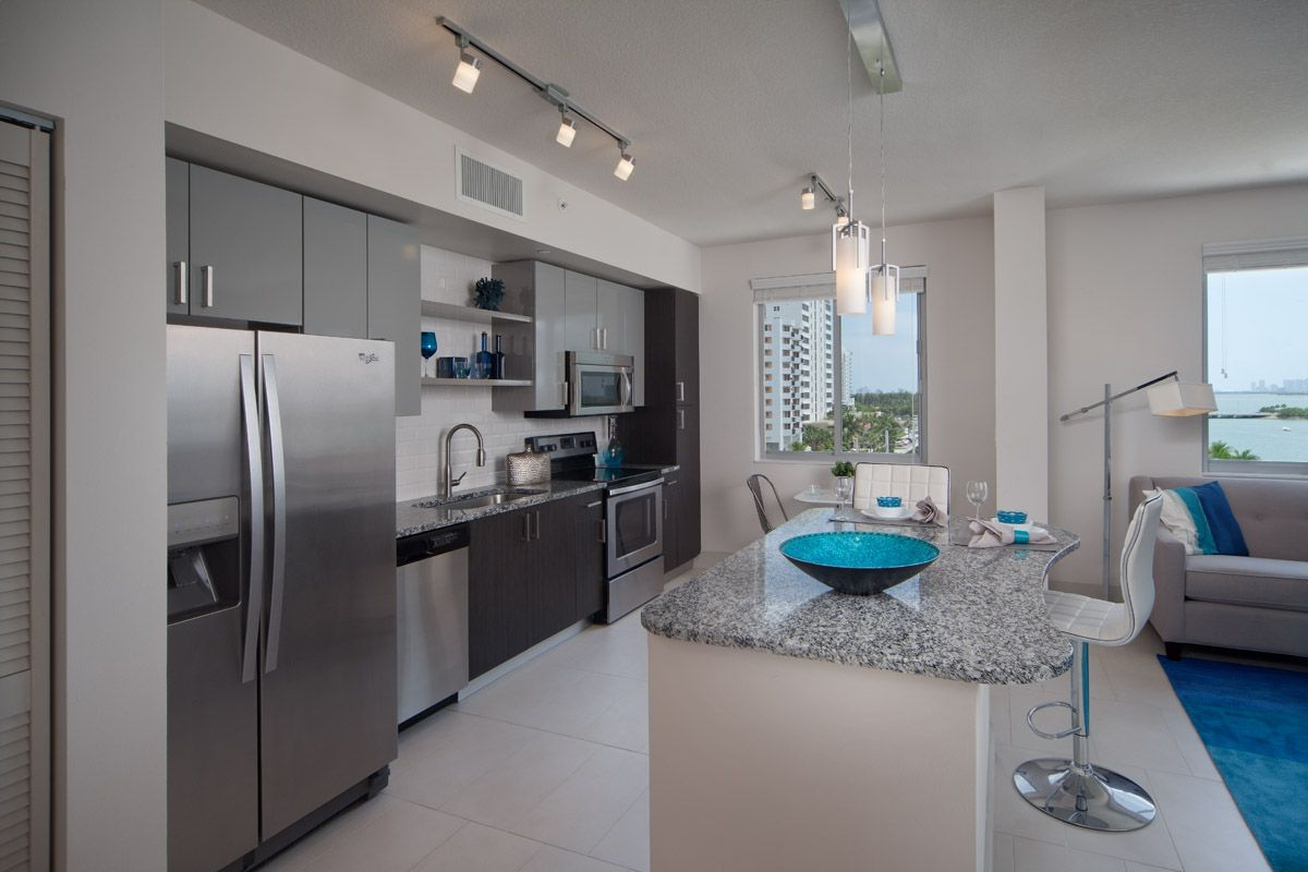 Apartment kitchen with stainless steel appliances and large island