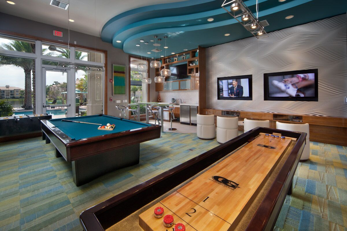 Clubhouse with a billiard table and shuffle board