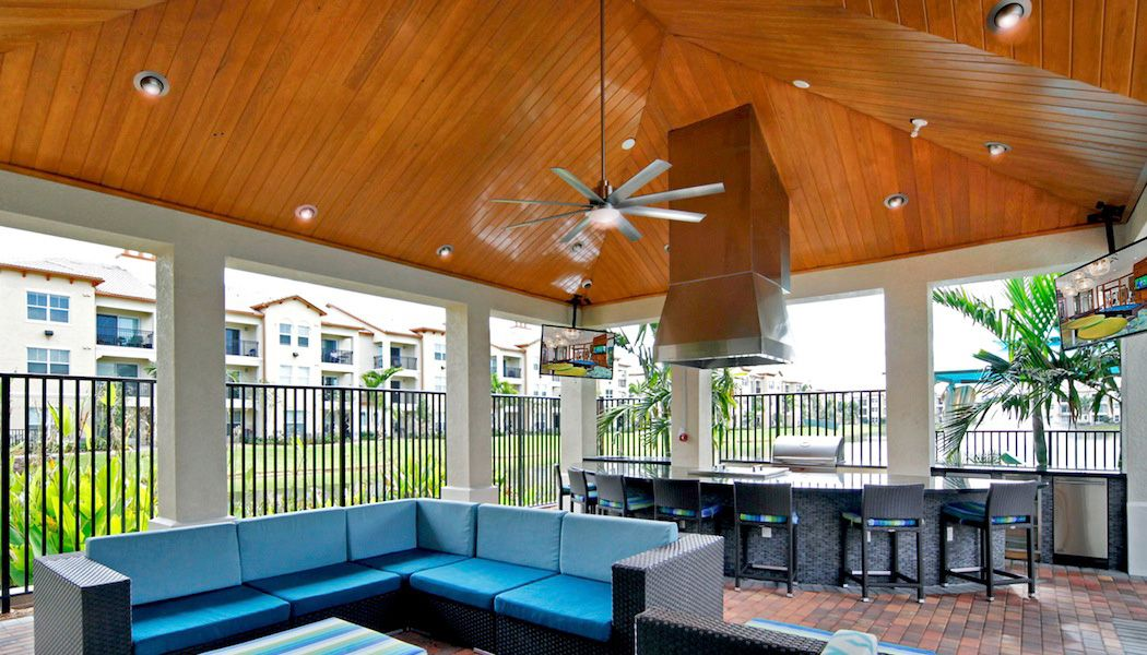 Outdoor kitchen area with grill and seating