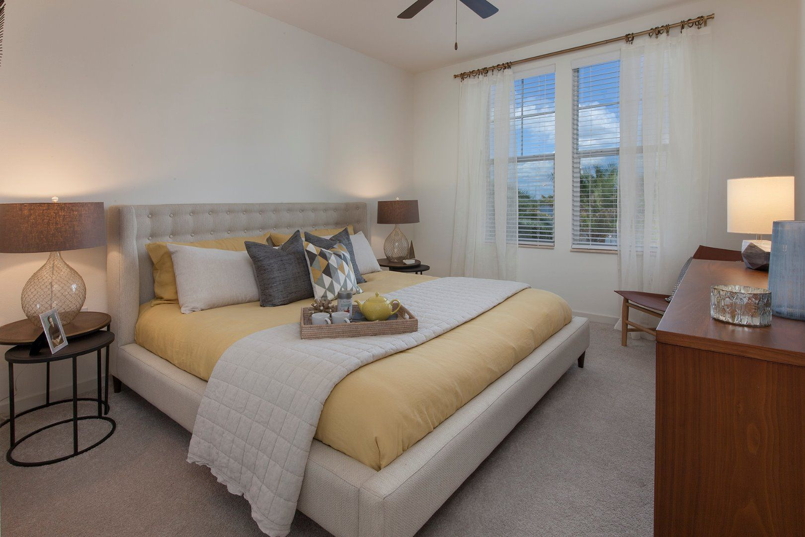 Bedroom with ceiling fan and large bed