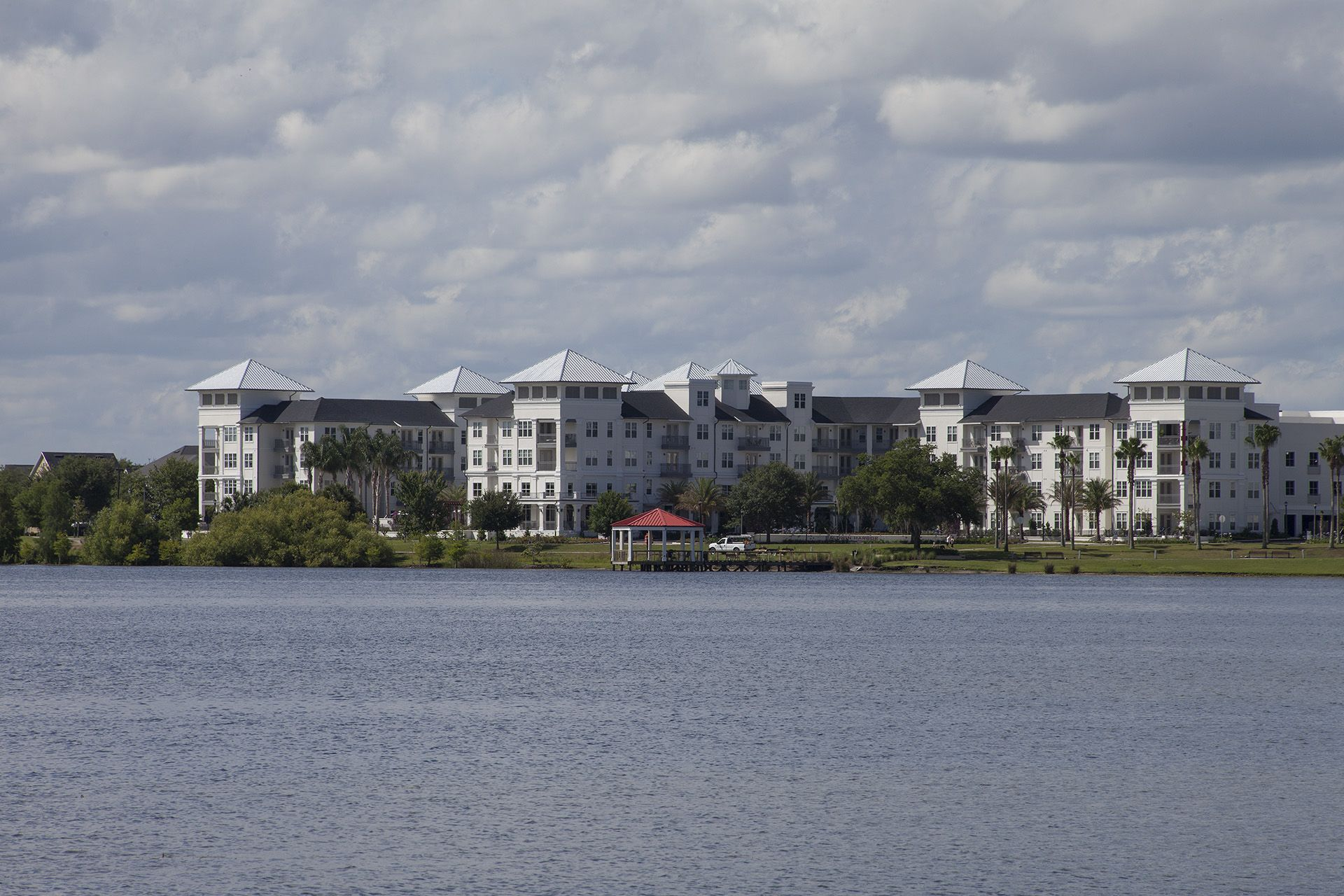 View of apartment building from across lake