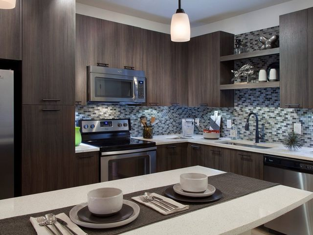 Kitchen with island and espresso cabinetry