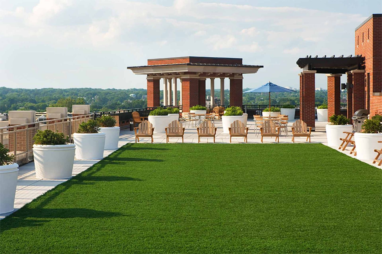 Rooftop area with seating and greenspace
