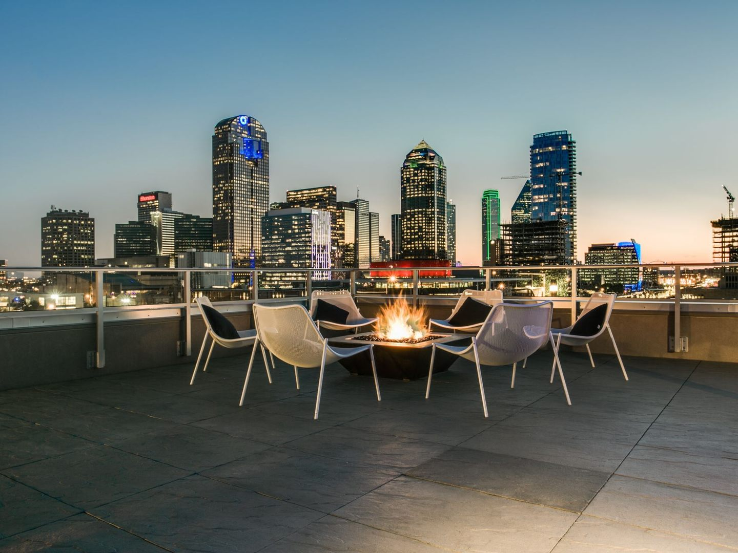 Rooftop patio fire pit with seating and views