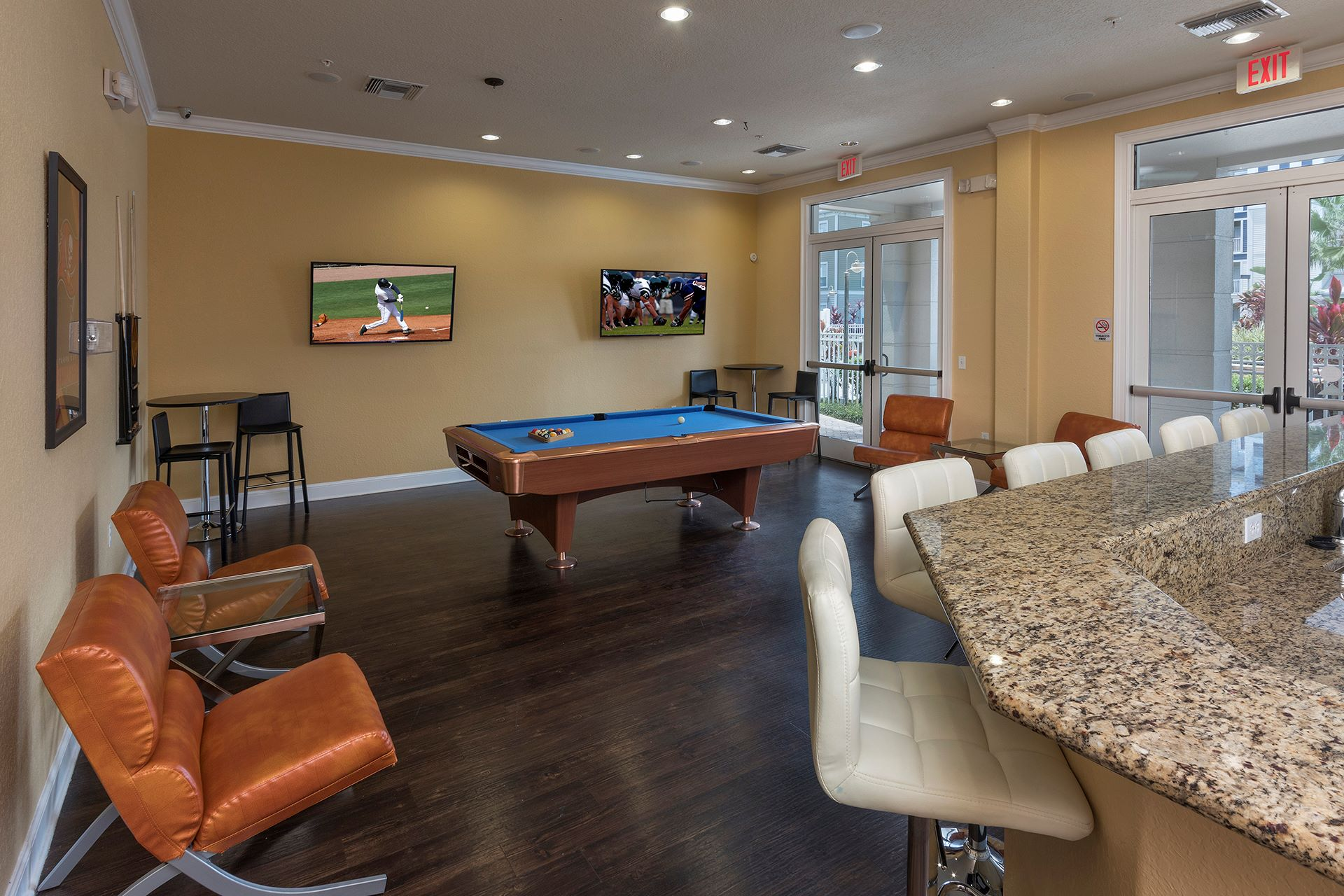 game room with pool table and TVs