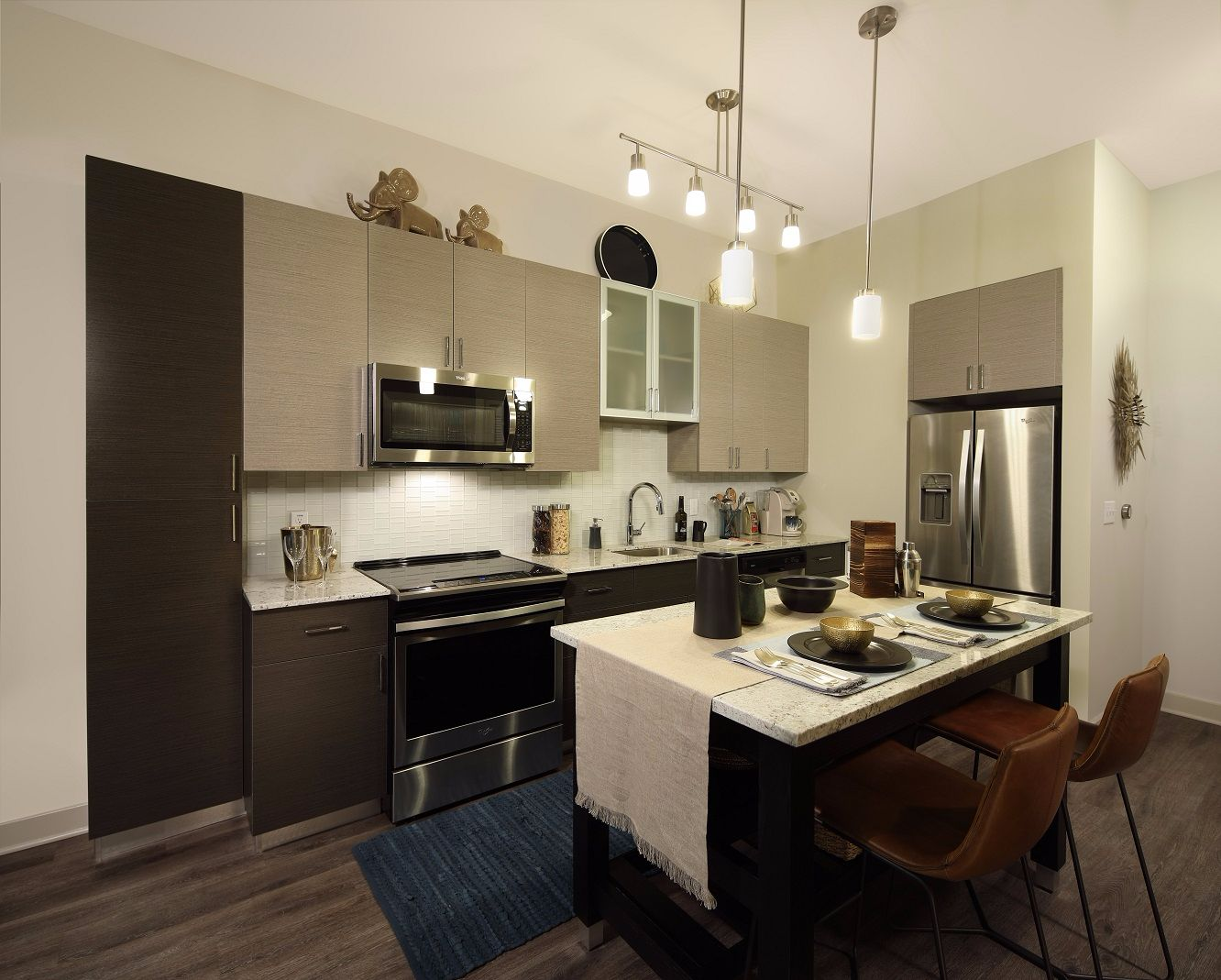 Apartment kitchen with island and pendant lighting