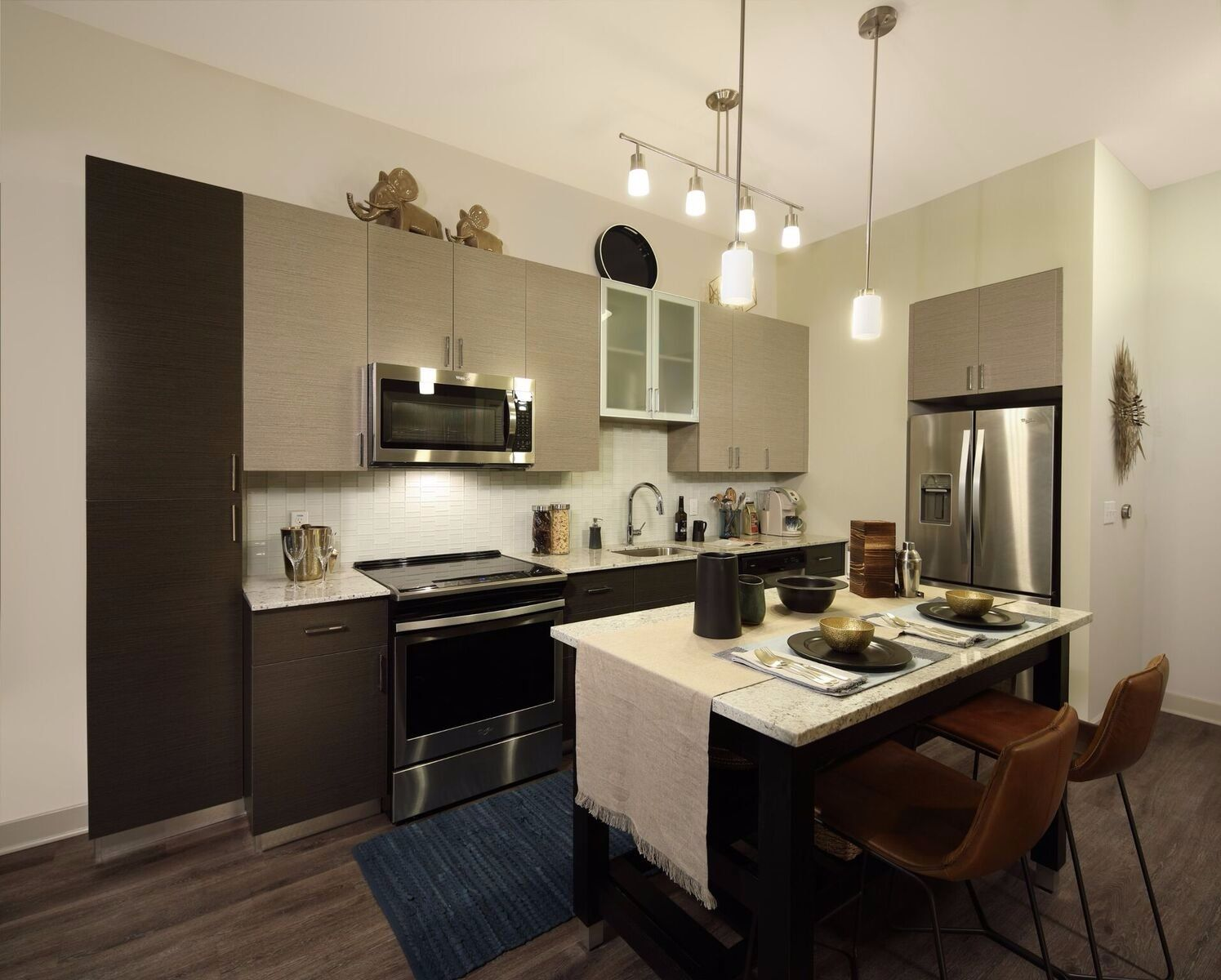 apartment kitchen with bar seating and pendant lighting