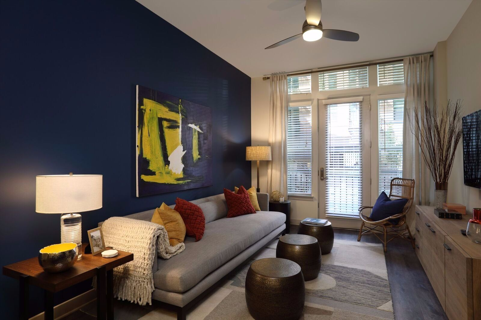 Apartment living area with blue accent wall and furniture