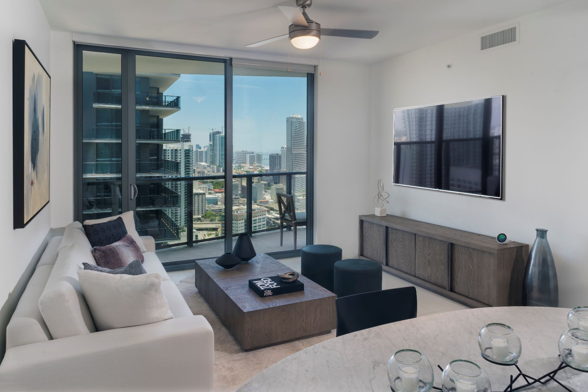 Apartment living room with balcony view of downtown