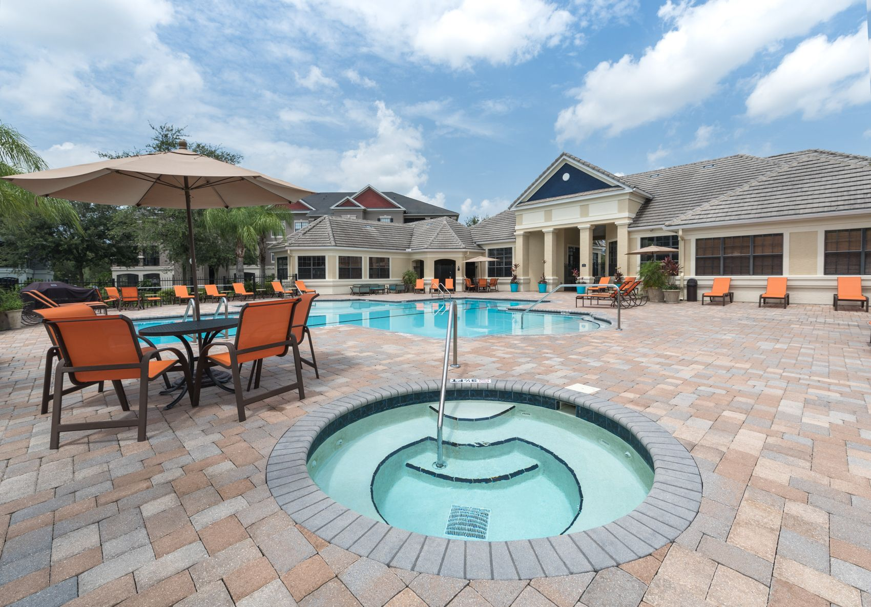 hot tub and outdoor table near pool
