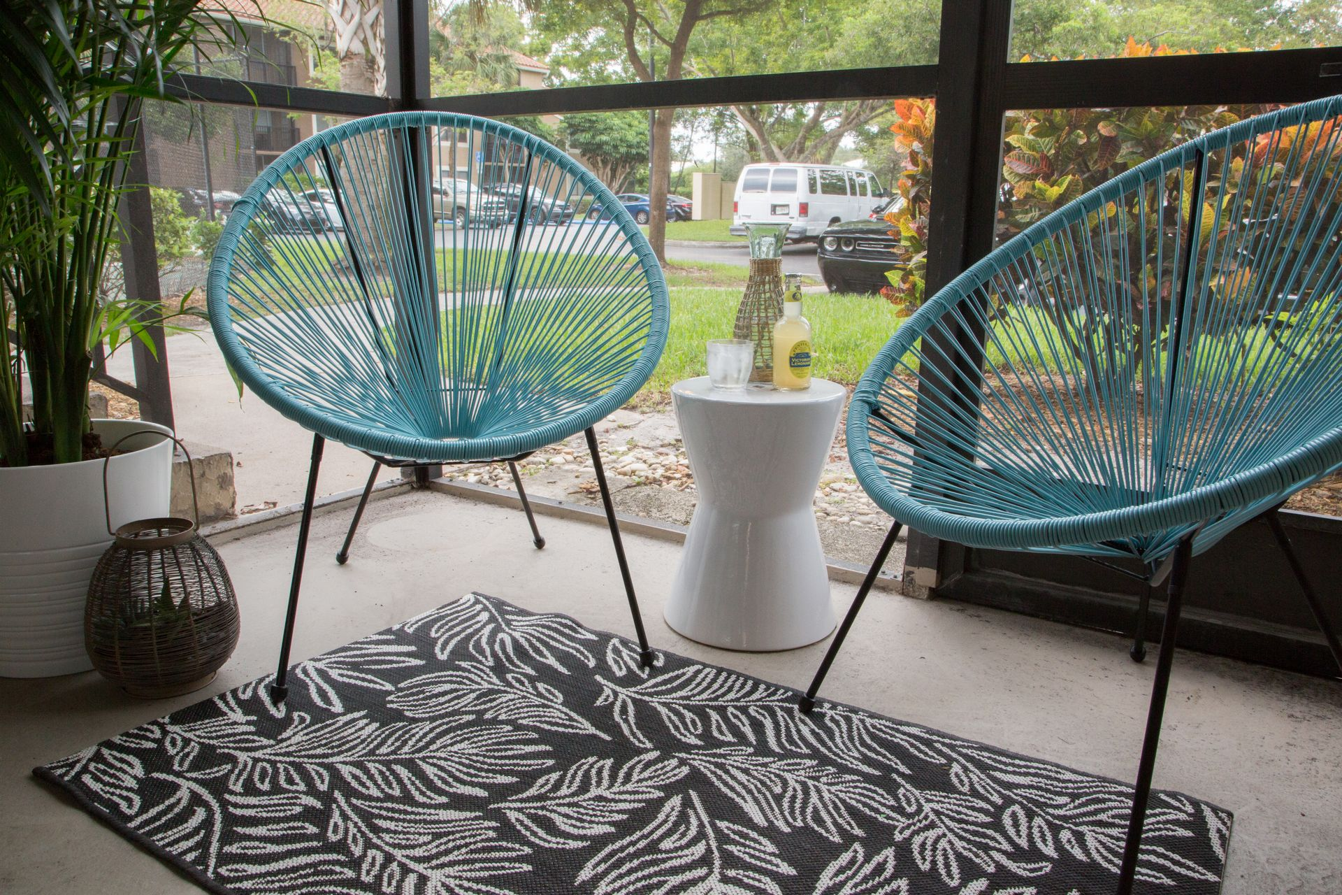 Two chairs on screened patio