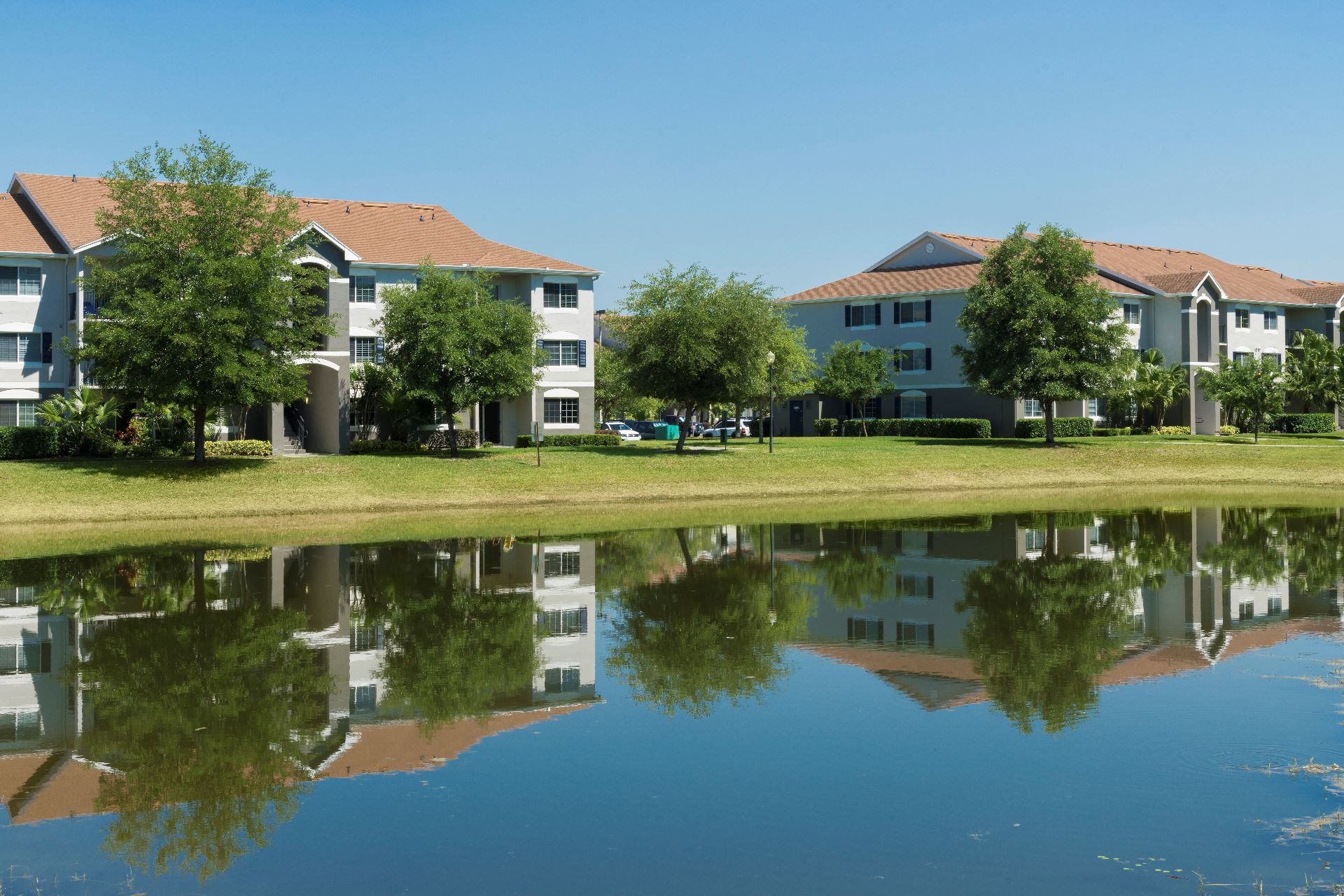 apartment buildings with reflection in lake