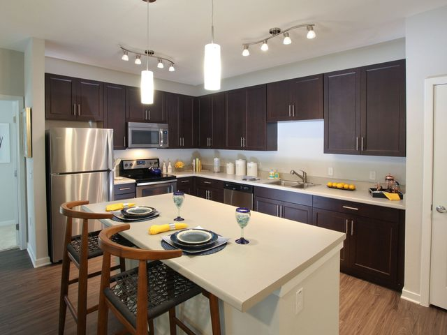 Apartment kitchen with island and stainless steel appliances