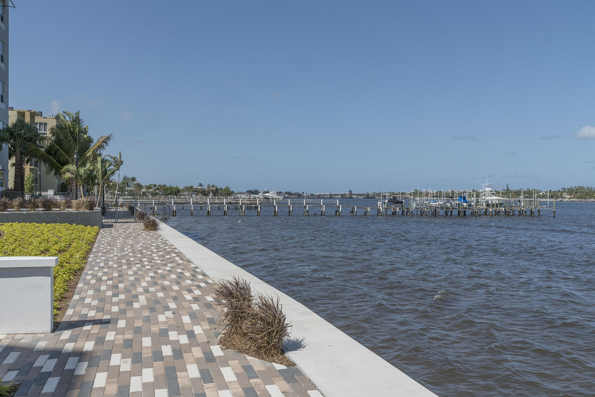 Walkway at the edge of the waterway with view of piers