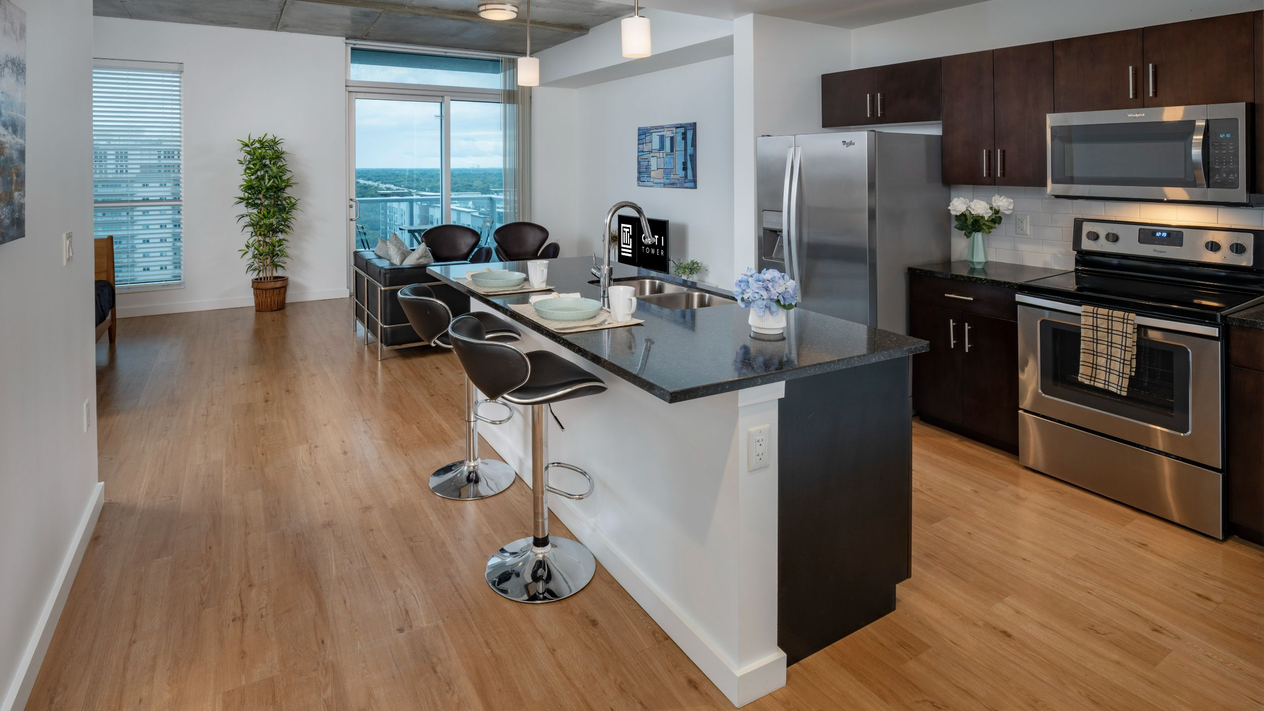 Apartment kitchen with stainless steel appliances and island