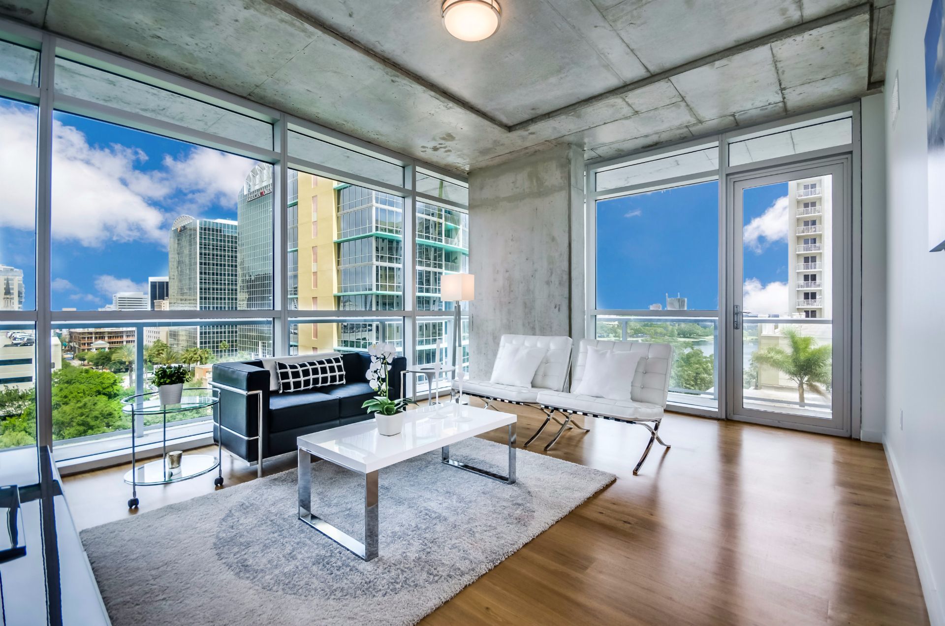 Apartment living room interior with wall-to-wall windows