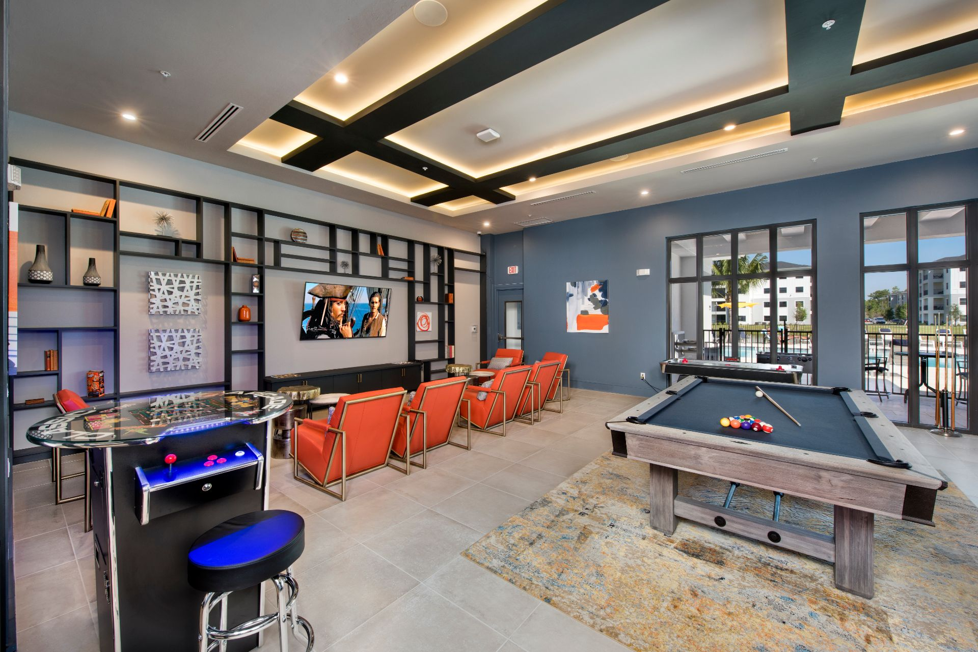 Entertainment room with pool table and TV