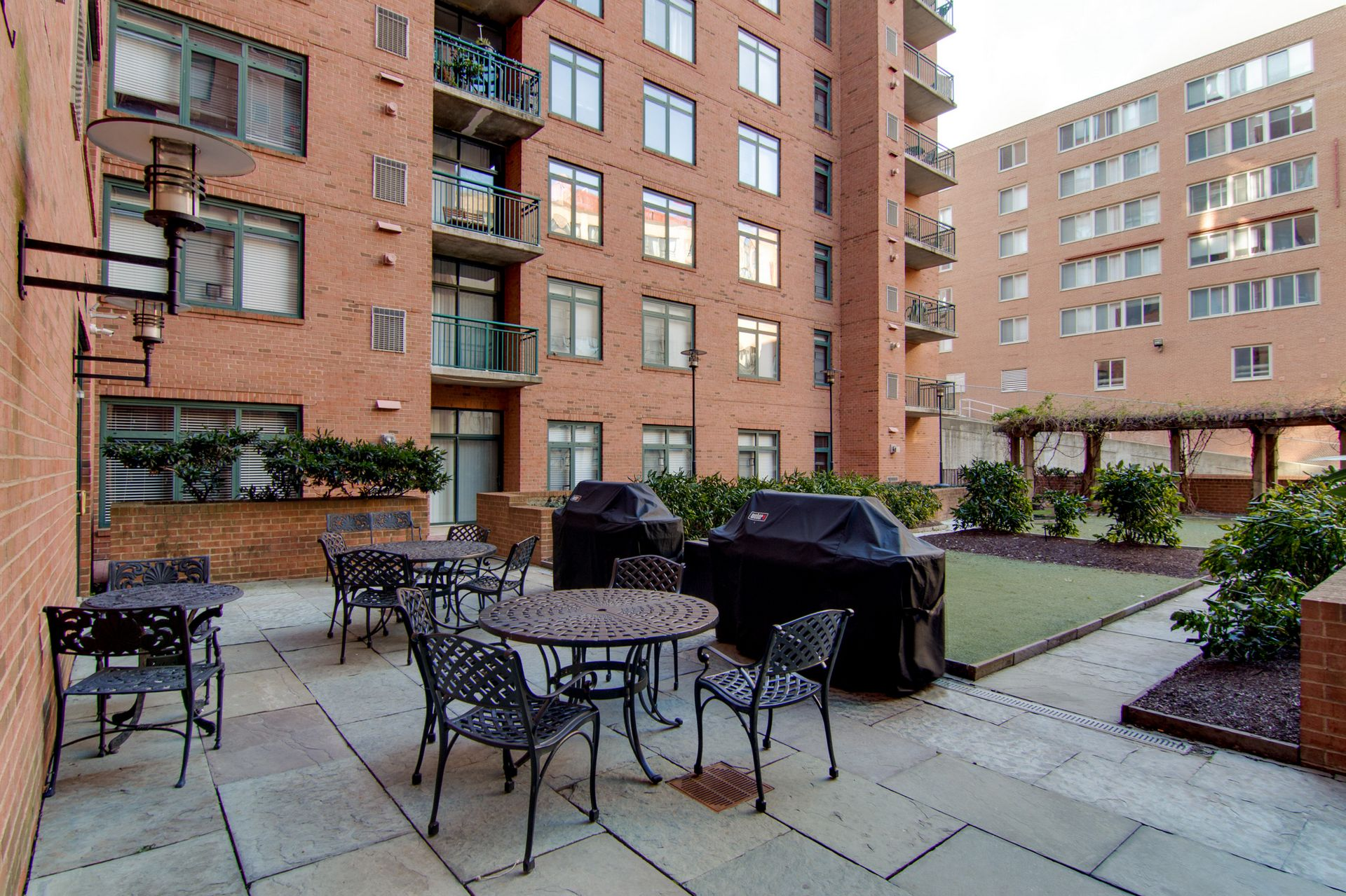 Patio area with seating, table, and grills