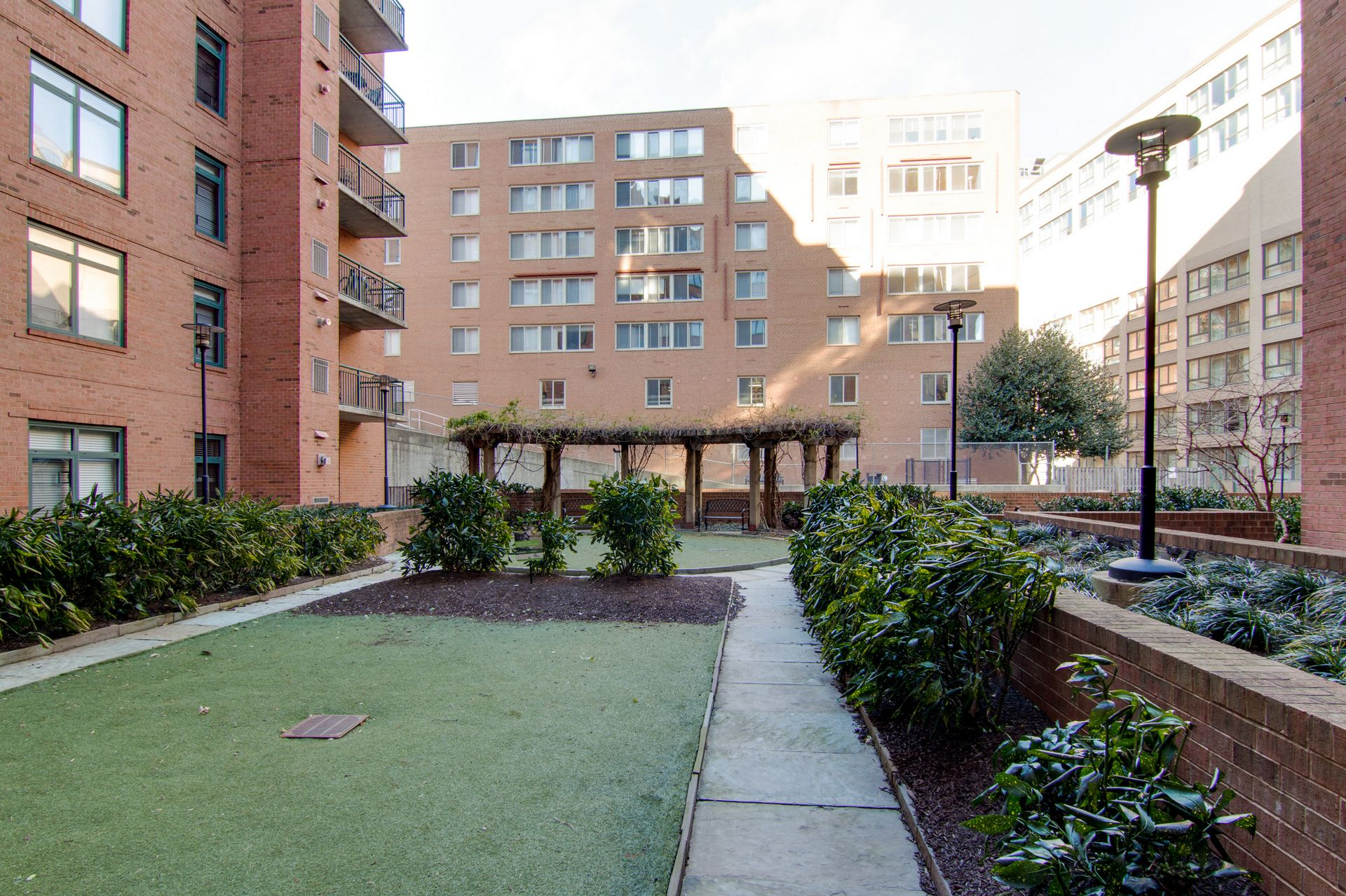 apartment courtyard with shrubs and trellis