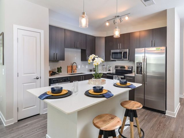 Kitchen with stainless steel appliances and island