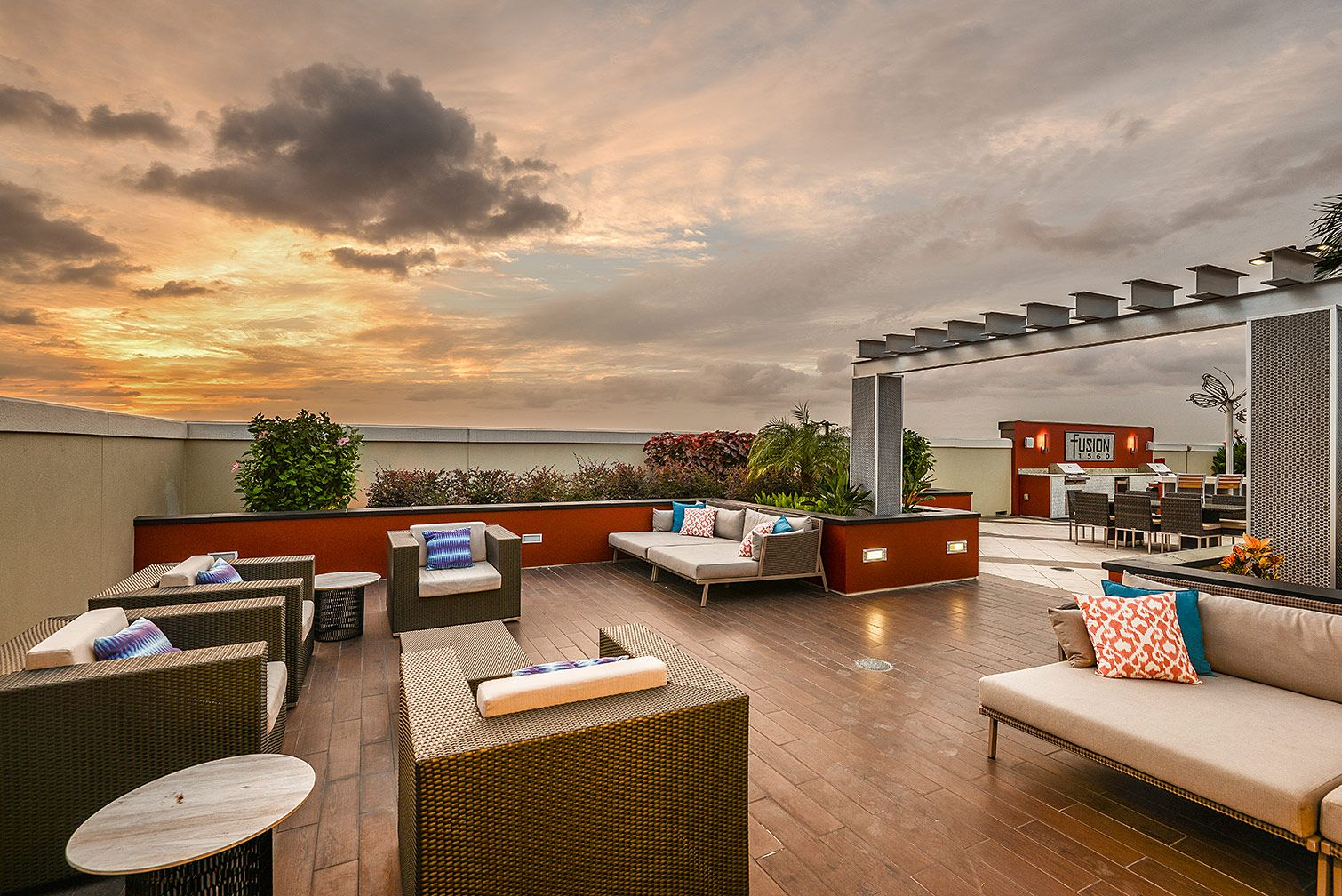 rooftop seating area with tables and grilling area