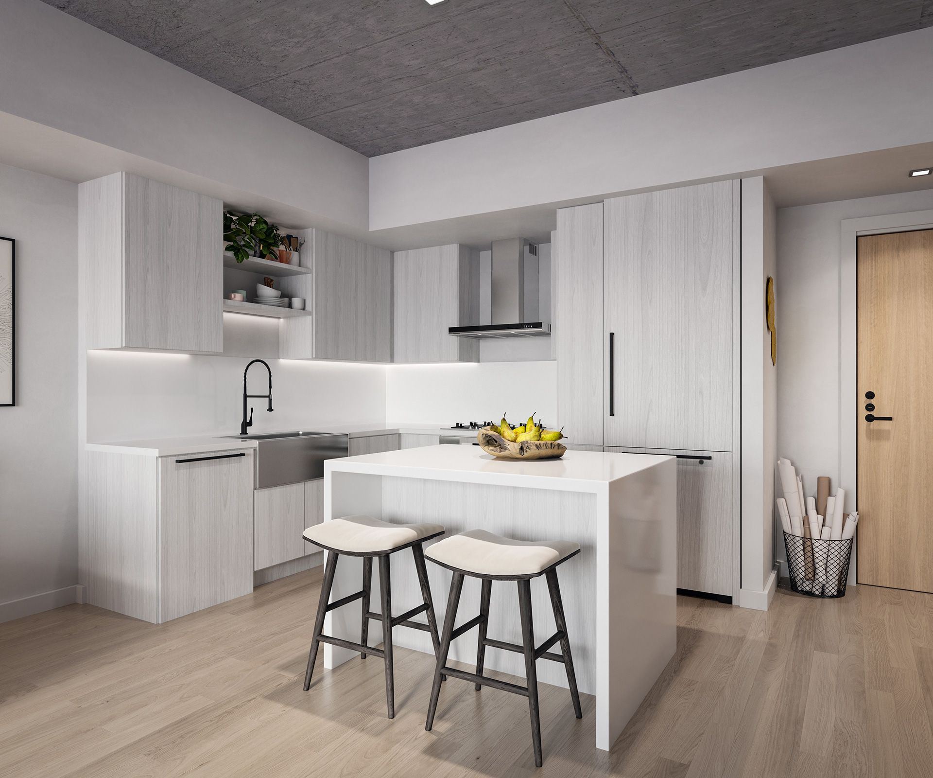 Apartment kitchen with white appliances and island