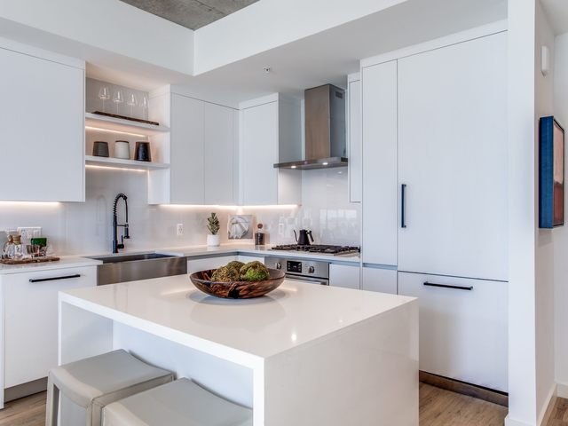 Apartment kitchen with white cabinetry and island