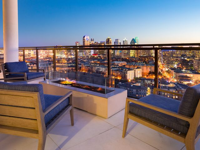 Seating area with fire pit and city views
