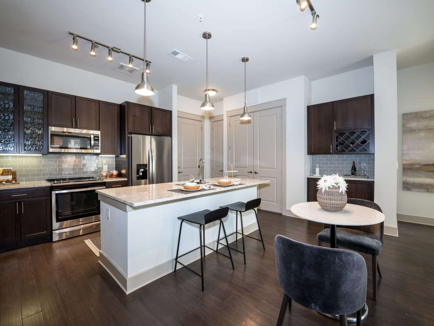 Open-concept kitchen with wood-plank flooring