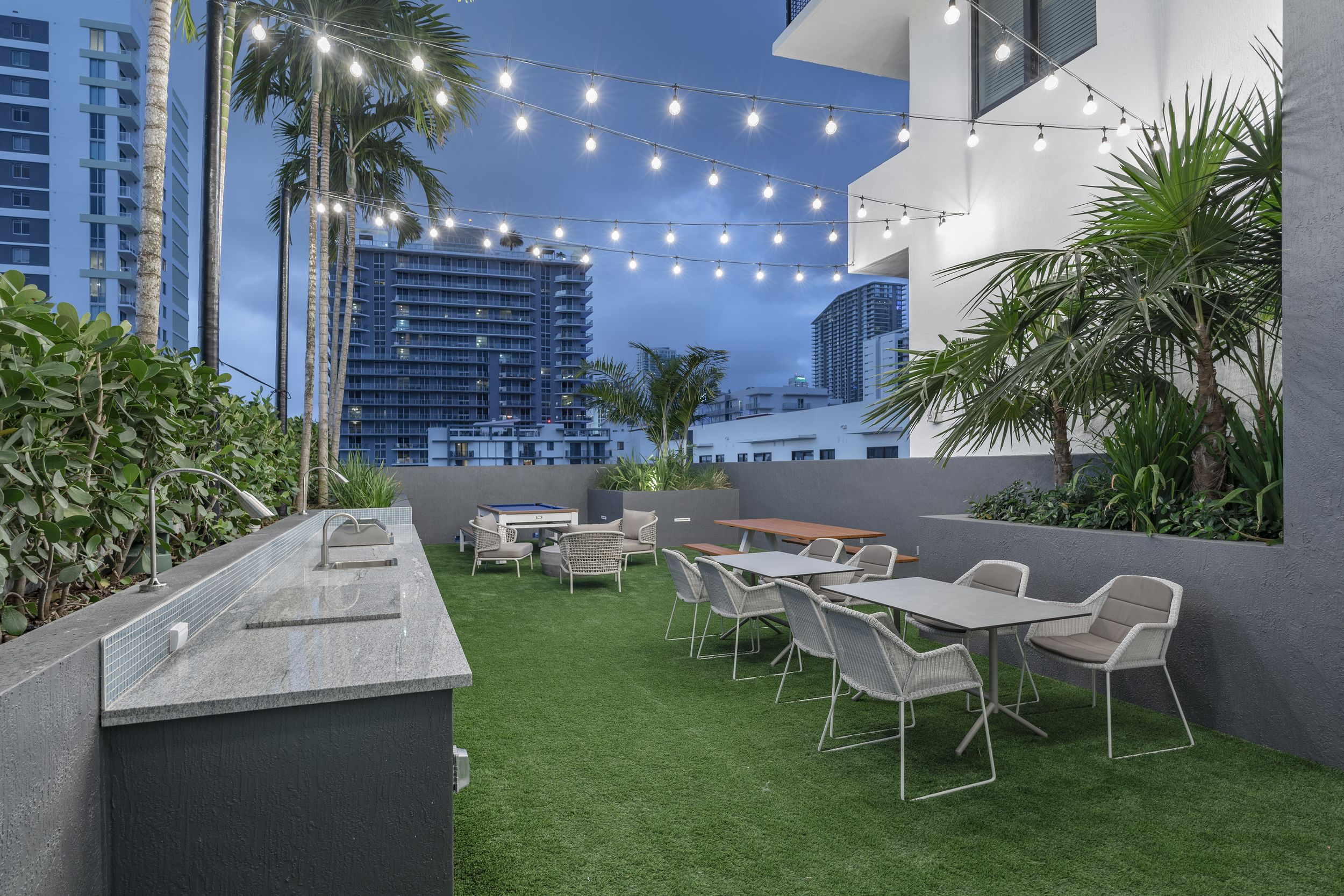 rooftop gathering area with seating and tables