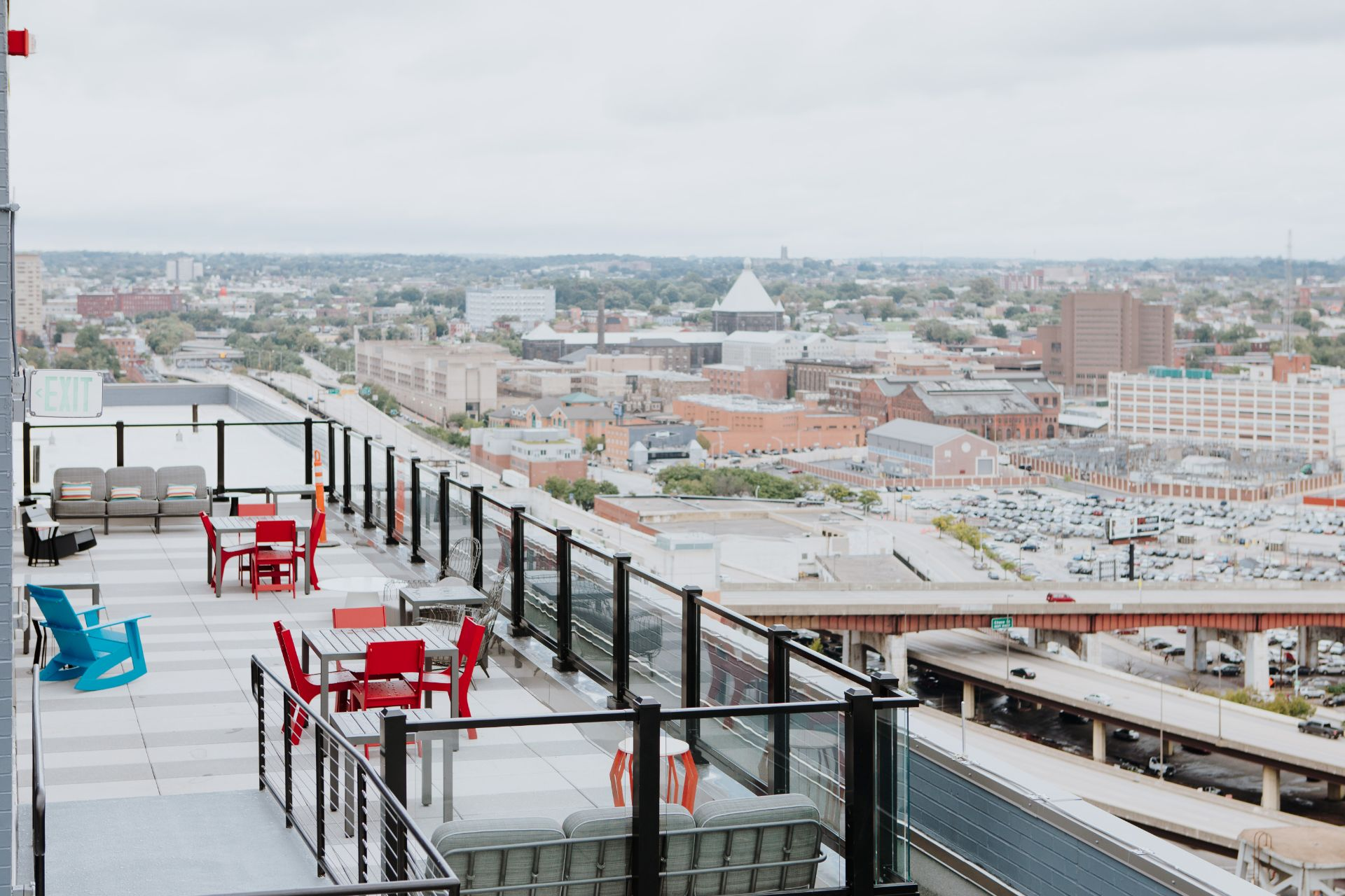 Rooftop lounge with seating and view of city