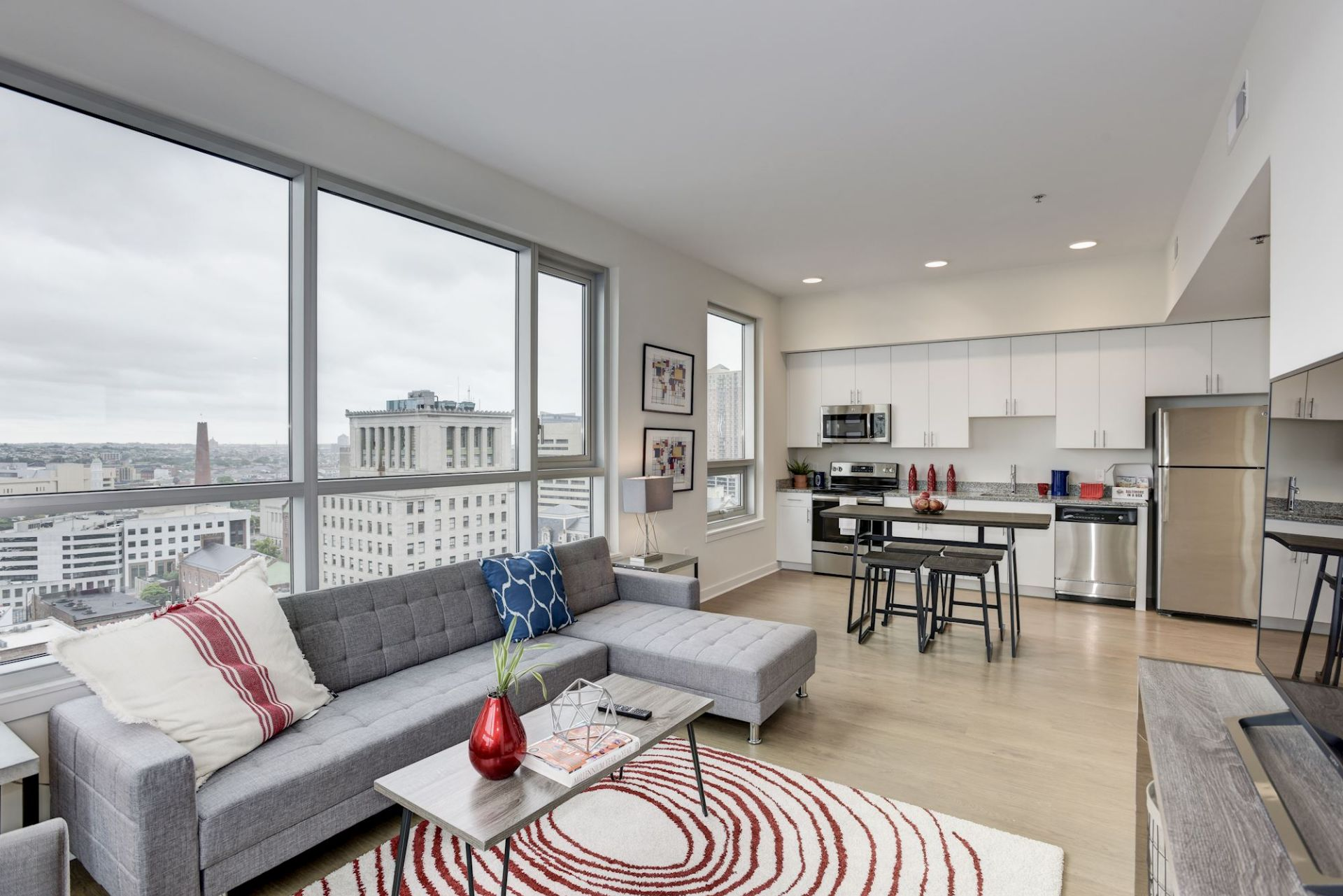 Apartment living and kitchen area with stainless steel appliances