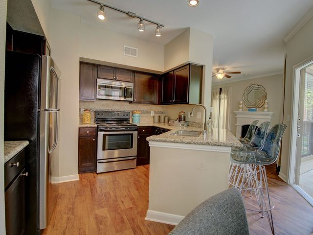 Apartment kitchen with stainless steel appliances and breakfast bar