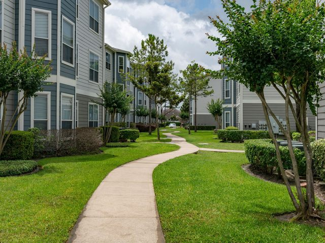 Exterior of apartment buildings with landscaping and walkway