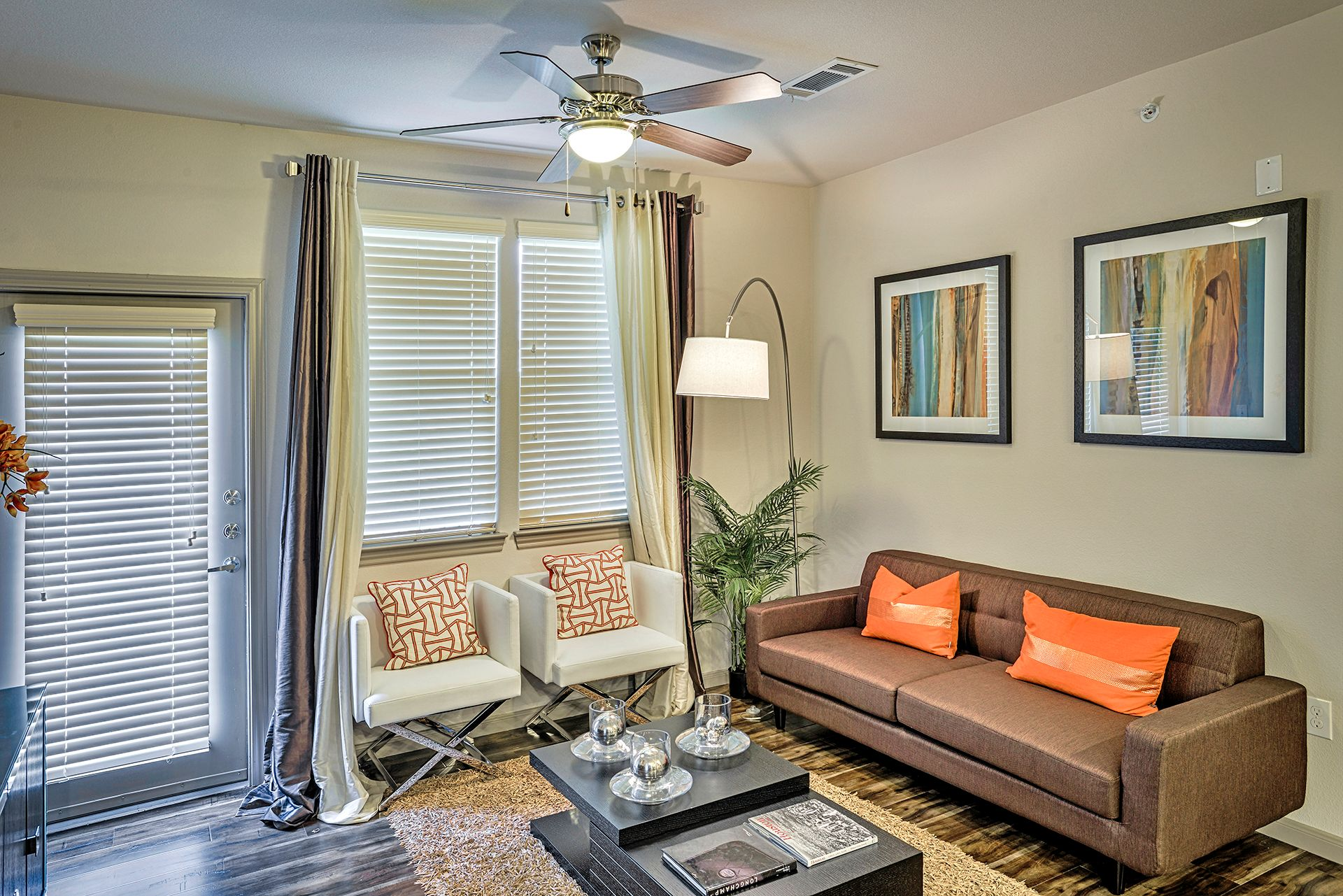 living room with ceiling fan and couch