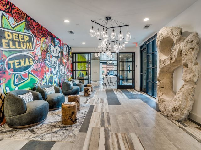 Resident clubhouse lounge area with modern mural