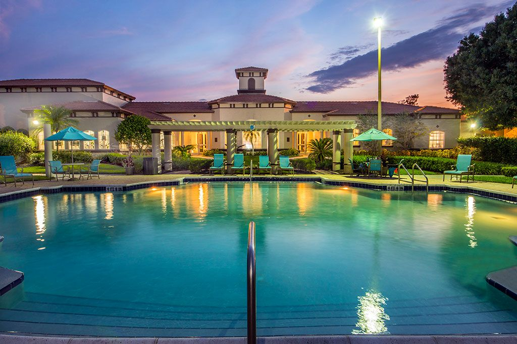 Pool facing clubhouse at sunset