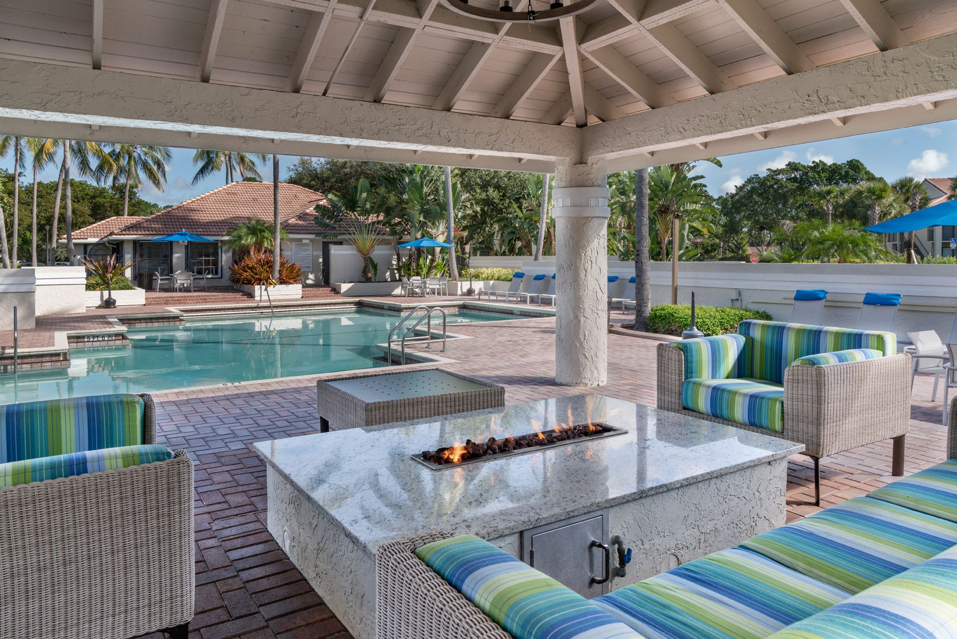 Outdoor fire pit next to swimming pool