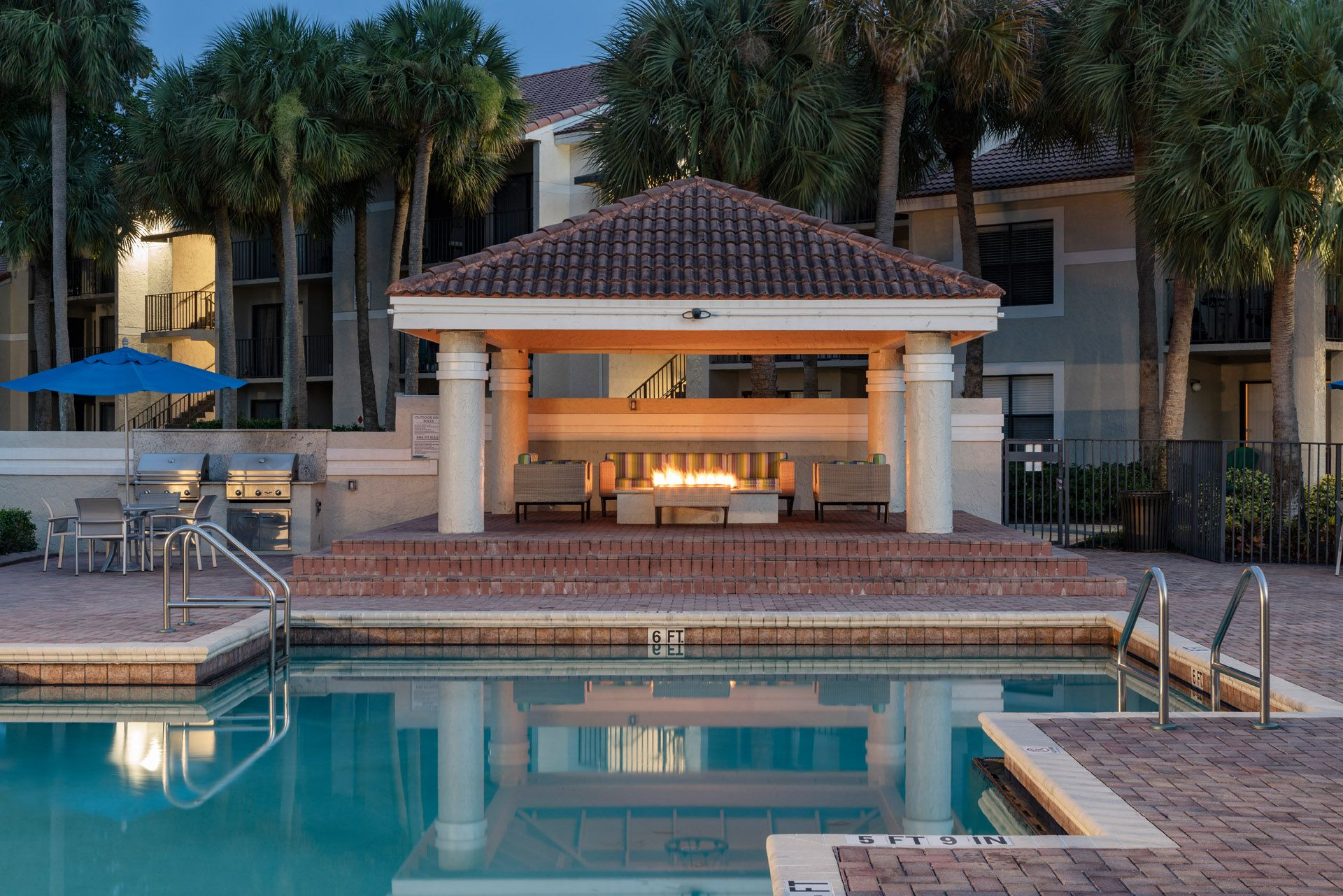 Swimming pool with seating and outdoor fire pit