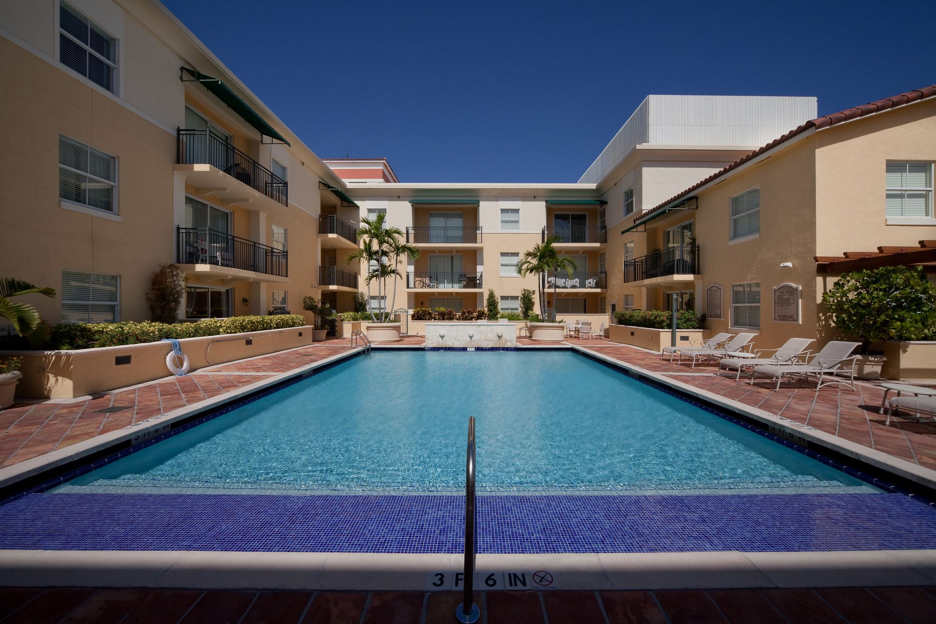 Pool area with apartments to the left and back