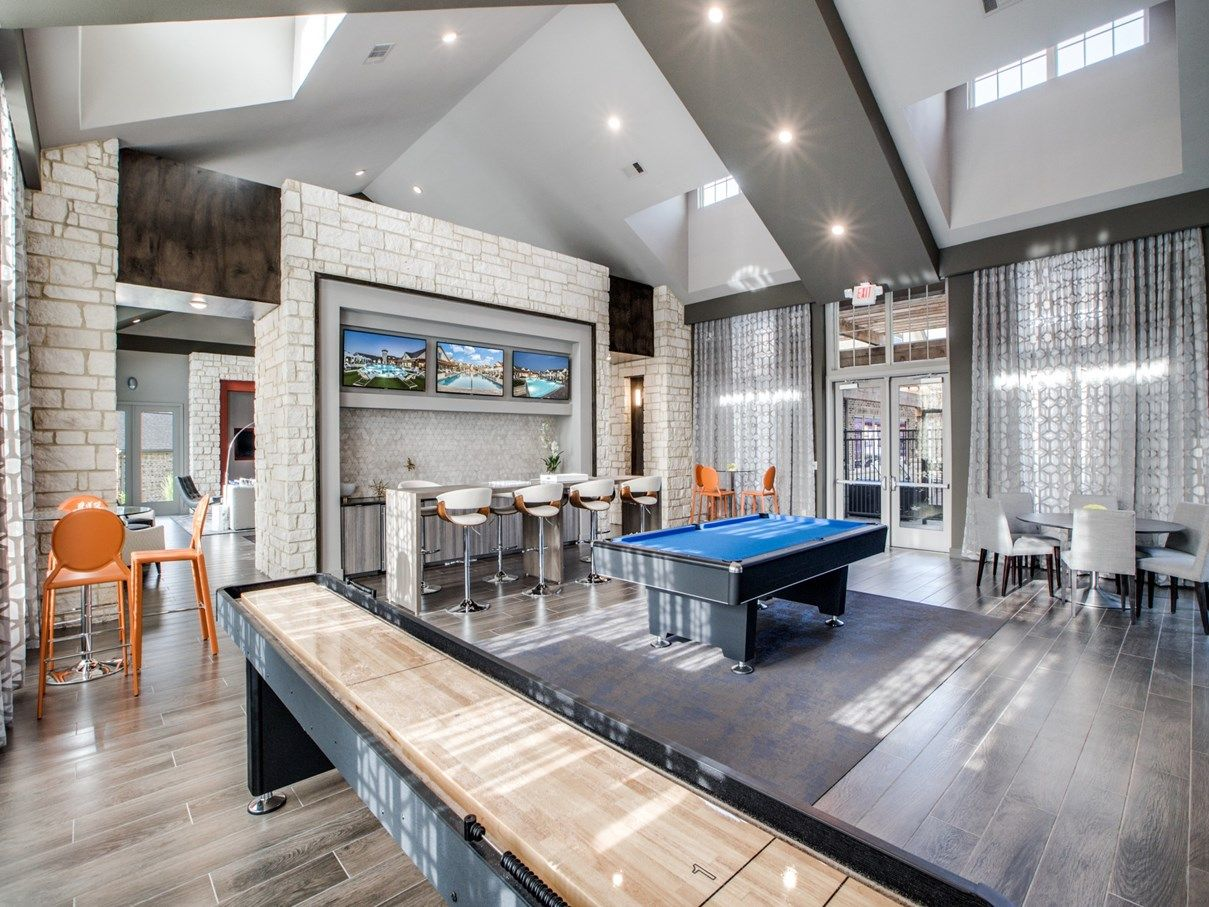 Game room with pool and shuffleboard