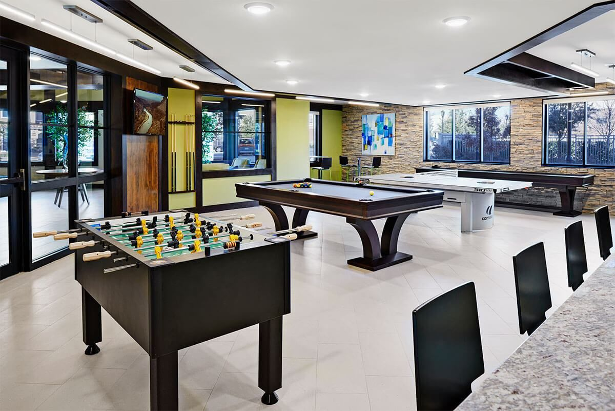 Game room with gaming tables and bar area