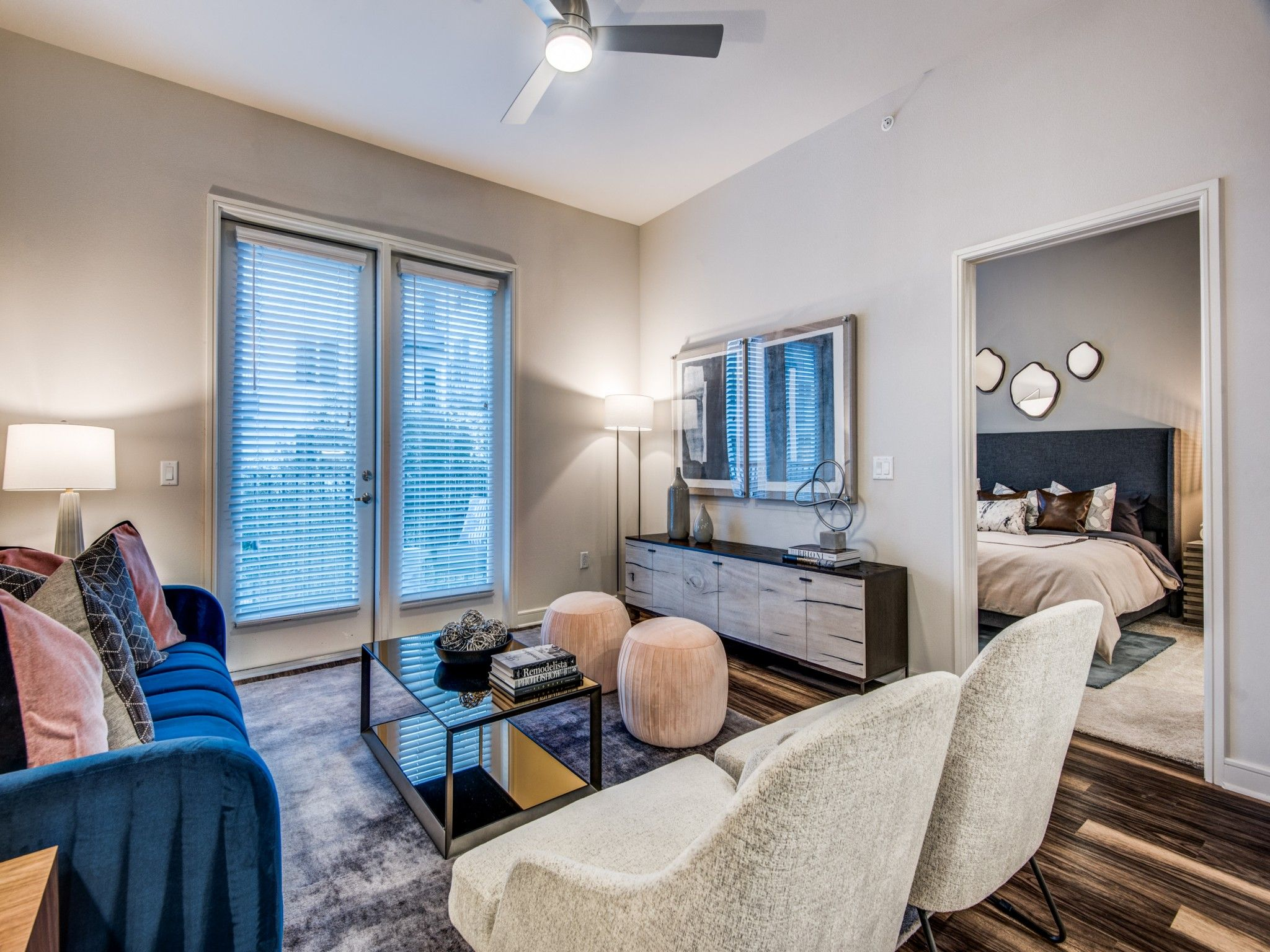Apartment living area with seating and view of bedroom