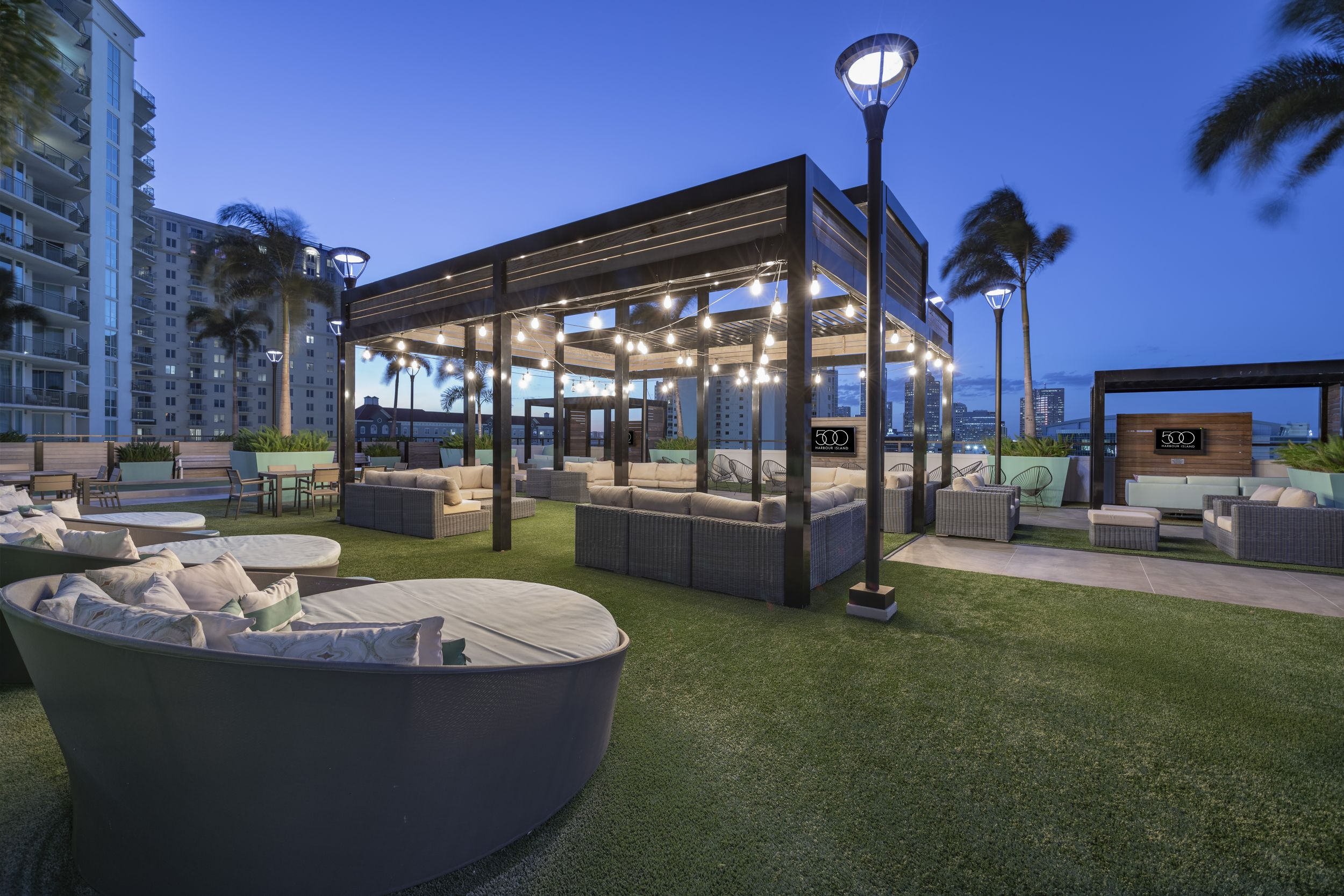 Outdoor rooftop area with seating and entertainment areas