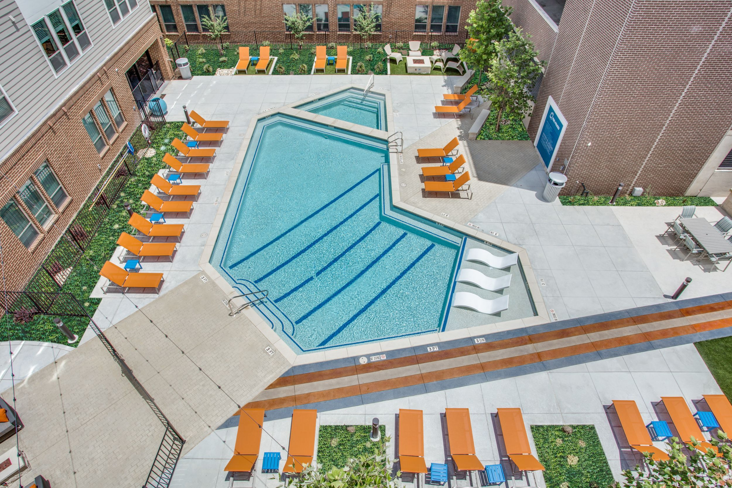 Aerial view of swimming pool with seating