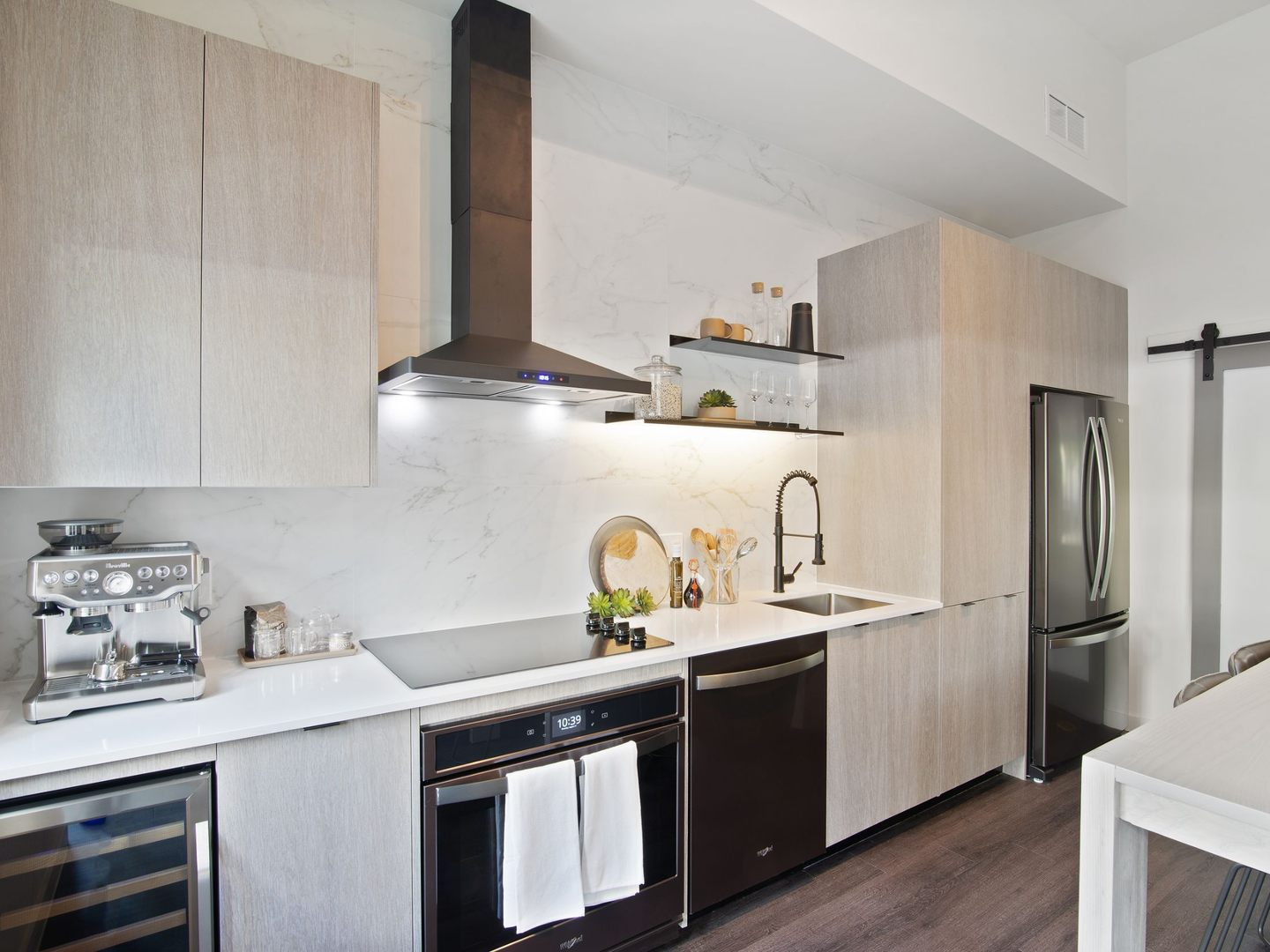 Apartment kitchen with black stainless steel appliances